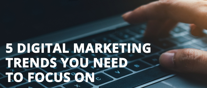 Business person types on keyboard researching digital marketing trends.